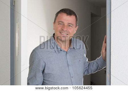 Charming And Handsome Man Opening The Door Isolated