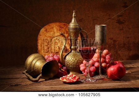 Red wine juicy pomegranate sweet grapes flat cake and copper jug poster