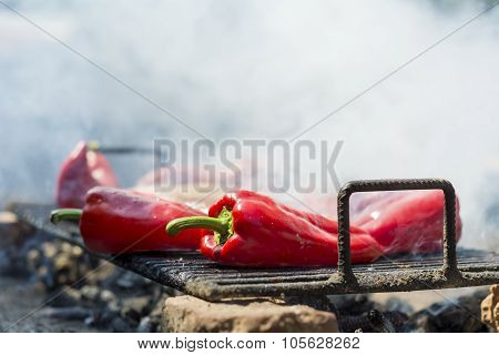 Red cillies frying on an improvised barbecue
