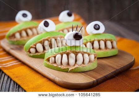 Spooky halloween edible apple monsters healthy natural dessert. Horror party decoration delicious sn