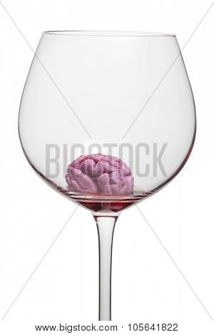 Glass with red wine shows that alcohol kills cerebral cells. For social advertising.