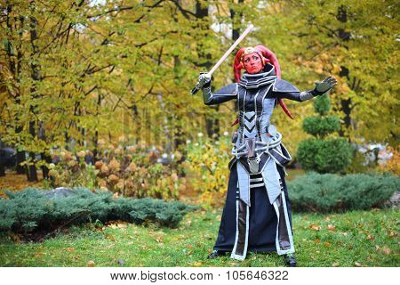 MOSCOW - OCT 12, 2014: Cosplayer Darth Talon with red head in a fantastic dress at the EveryCon 2014 in the exhibition center Sokolniki