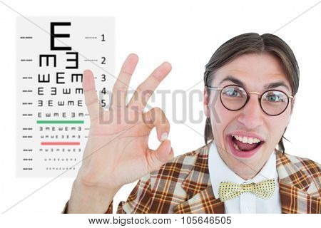 Geeky hipster doing the ok sign against eye test