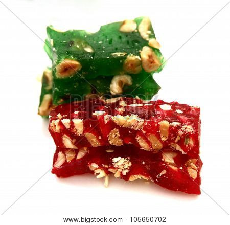 Turkish delight with hazelnuts isolated on white background poster