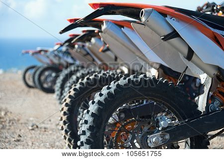 Motocross riders lined up before start on the race