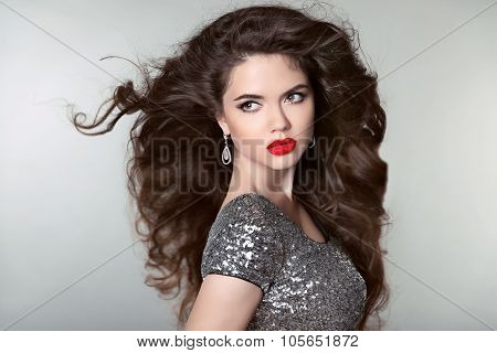 Hair. Beautiful Brunette Girl. Healthy Long Hair. Red Lips. Fashion Earrings Jewels. Beauty Model Wo