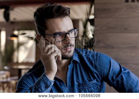 Man Staring Aside And Using Mobile Phone