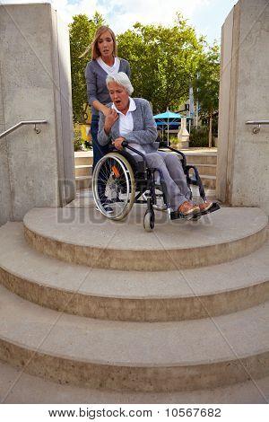 Woman In Wheelchair Is Afraid Of Steps