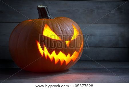 Scary Face Lack O Lantern On Wooden Dark Background