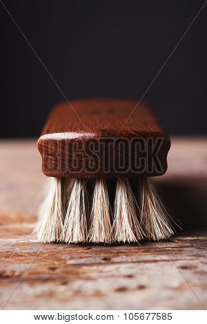 Close Up Of A Shoe Shine Brush On A Rustic Background