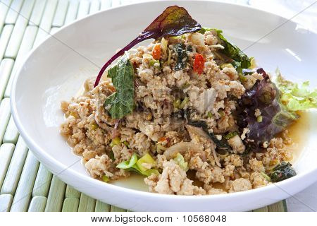 Larb chicken salad. Traditional Thai food with ground chicken and rice lime chili and herbs. poster
