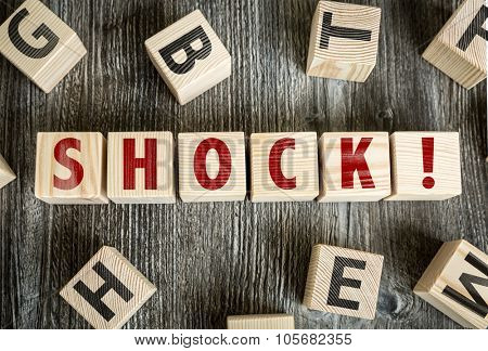 Wooden Blocks with the text: Shock!