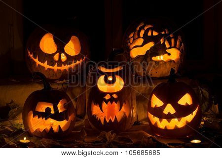 Photo Composition From Five Pumpkins On Halloween.