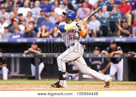 DENVER-AUG 21: New York Mets outfielder Yoenis Cespedes swings a pitch during a game against the Colorado Rockies at Coors Field on August 21, 2015 in Denver, Colorado.