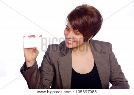 Smiling woman with a white card in her hand