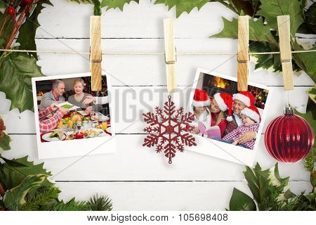 Hanging christmas photos against white wood