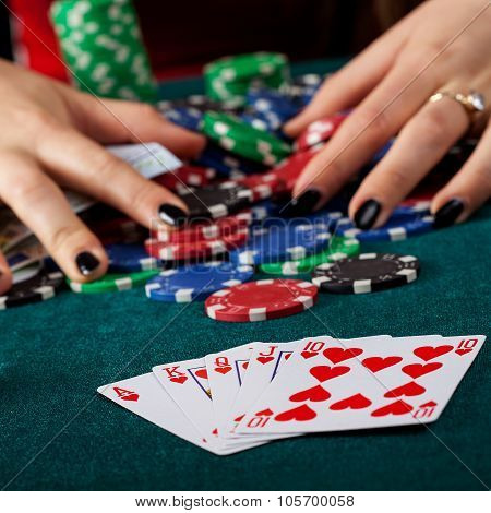 A closeup of a royal flush on a gambling table poster