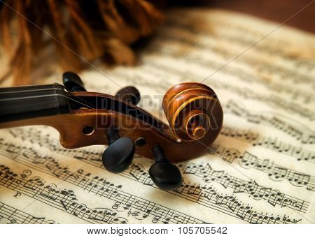 Violin head on sheet music