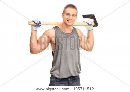 Handsome young logger carrying an axe on his shoulders and looking at the camera isolated on white background