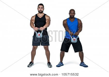 Strong friends lifting kettlebells together on white background poster