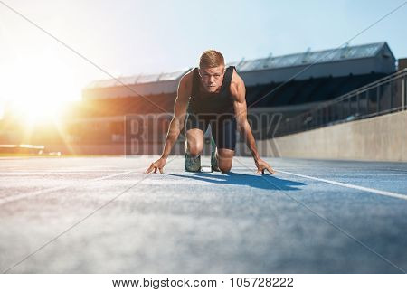 Athlete In Starting Position Ready To Start A Race