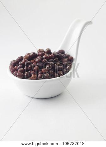 adzuki bean in a white saucer