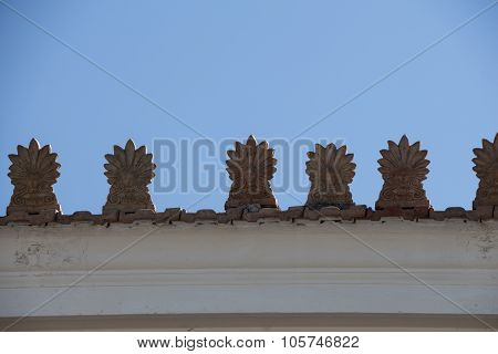 Rooftop with Akrokeramo ceramic decorative antefix and clear blue sky