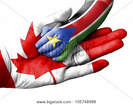Adult Man Holding A Baby Hand With Canada And South Sudan Flags Overlaid. Isolated On White