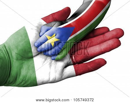 Adult Man Holding A Baby Hand With Italy And South Sudan Flags Overlaid. Isolated On White