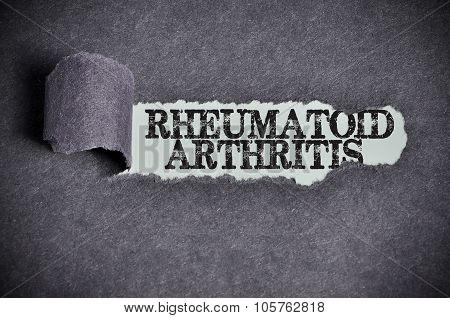 Rheumatoid Arthritis Word Under Torn Black Sugar Paper