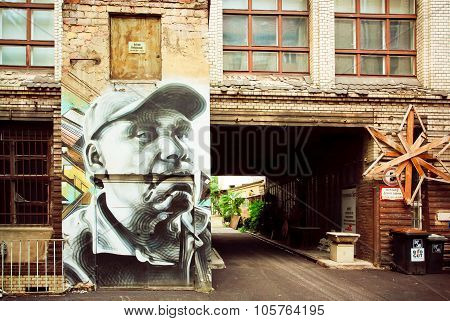 House With A Portrait Of An Elderly Man In Graffiti Style