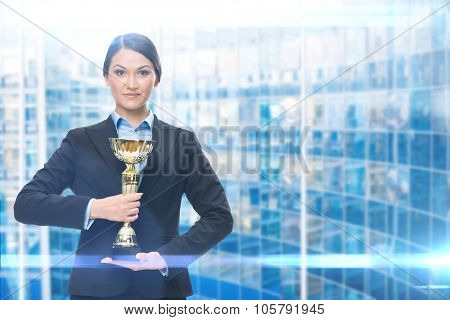 Portrait of business woman with cup, blue background. Concept of win and success