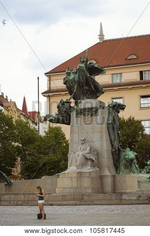A Young Girl Stands At The Foot Of The Monument Of Frantisek Palacky