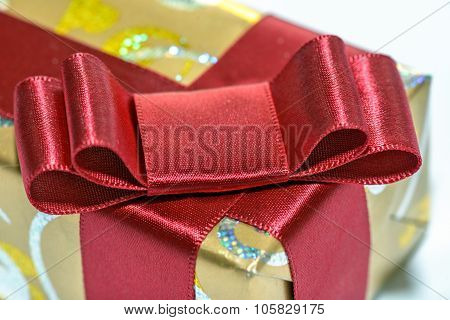 Wrapped Gift With Red Ribbon And Bow