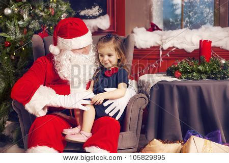Little Girl Telling Her Christmas Wish In Santa Claus