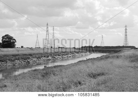 Overhead Power Lines Span The River Nene In Cambridgeshire
