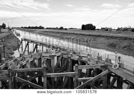 Approach On River Nene At Low Tide To Crosskeys Bridge