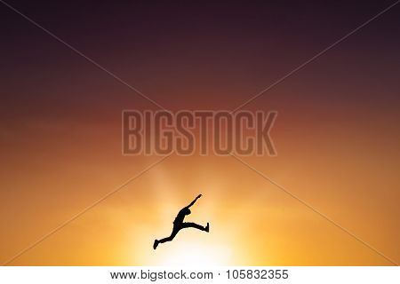 Male Person Leaps On The Air At Dusk Time