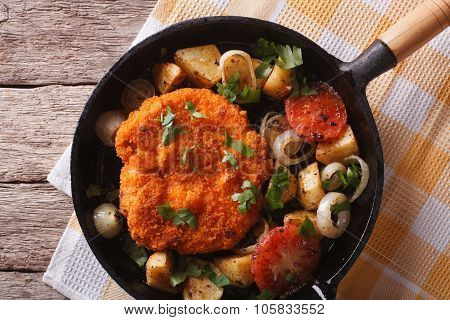Weiner Schnitzel With Vegetables In A Pan Closeup. Horizontal Top View