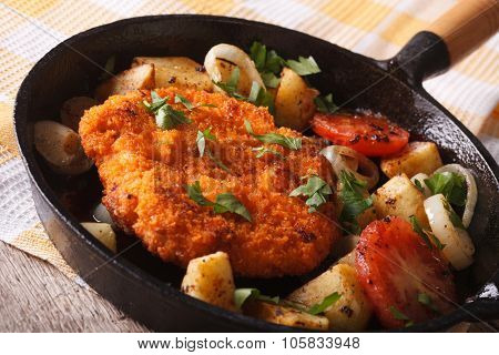 Breaded German Weiner Schnitzel With Fried Vegetables In A Pan
