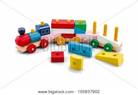 Wooden Puzzle Toy Train With Colorful Blocs Isolated Over White