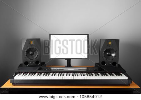 digital audio workstation (daw) studio with electronic piano and monitor speakers poster