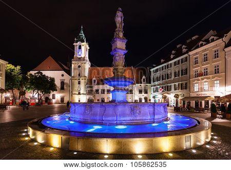 Maximilian Fountain In Bratislava Town In Night