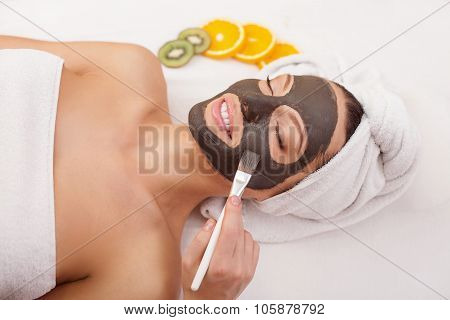 Cheerful lady is having skin care treatment
