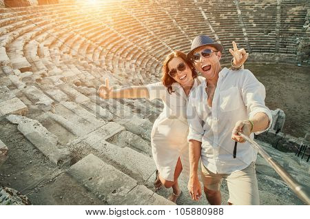 Happy Young Couple Take Self Photo In Side Amphitheatre