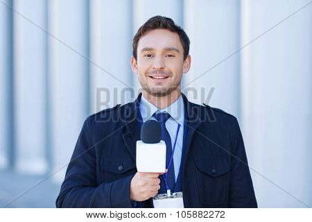 Smiling journalist is ready to record reportings.