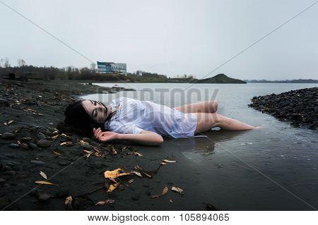 Girl Lying On Dark River