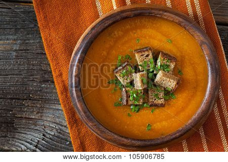Natural vegetarian pumpkin cream soup with croutons delicious organic food recipe. Traditional hallo