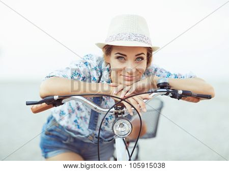 Happy Woman With Bicycle On The Beach