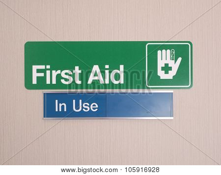 First aid door sign with occupied indicator